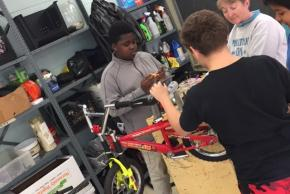 Students in Bike Shop fixing up some bikes!