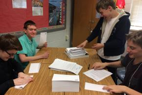 photo of NJHS students assembling letters to send out for the school