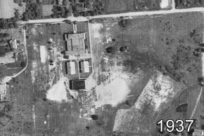 Black and white aerial photograph of Herndon High School taken in 1937. There is one main school buildings and three smaller outbuildings.
