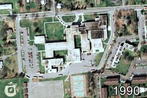 Color aerial photograph of Herndon Middle School taken in 1990. The physical layout is almost identical to the 1972 photograph, except the original 1927 building has been torn down.