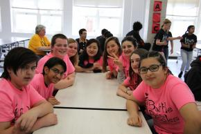 image of the pale pink team smiling, ready to compete