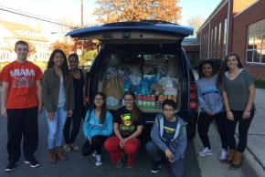 photo of NJHS students with canned goods for the annual Food Drive!